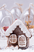 Sweet Christmas gingerbread cookies in shape of house and Christmas trees