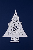 Christmas tree made of sugar icing on deep blue background