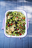 Bulgur salad with dried black olives and herbs