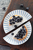 Berry tartlet on two halves of plates