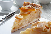 A piece of tart with apples and almond flakes