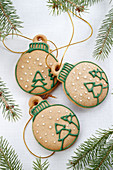 Christmas gingerbread in the shape of Christmas tree bauble with strings