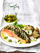 Salmon fillet with crusted pecorino pesto topping with olive oil