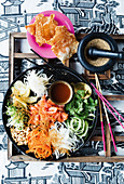 Yusheng (Raw salmon salad bowl, Malaysia)