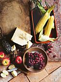 Corn, parmesan, apples and grapes