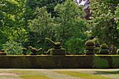 Geschnittene Hecke mit Topiary