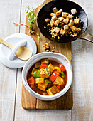 Pepper and tofu goulash with nut croutons