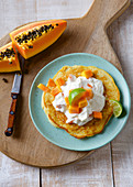 A coconut pancake with papaya quark