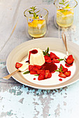 Semolina pudding with strawberry sauce
