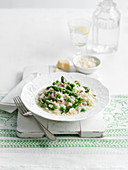 Risotto with ham, peas and green asparagus