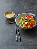 A tamago bowl with tahini and courgette noodles and marinated radishes