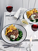 Grilled beef steak with spinach, potatoes and bearnaise sauce