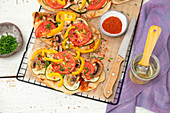 Flammenkuchen with onion, courgettoe, mushrooms and tomato, vegan