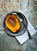 Half a baked acorn squash with brown sugar and butter