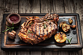 Grilled T-bone steak on a serving board