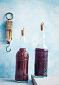 Two bottles of homemade cranberry juice