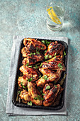 Grilled hot and spicy chicken wings on serving pan