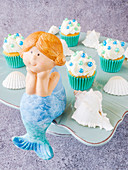 Mini cupcakes with cream and a mermaid