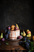 Layers Cake Decorated with Fruits