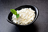 Fresh cottage cheese in a metal bowl