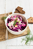 Herring salad with apple and beetroot