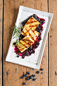 Grilled halloumi with a blueberry and rosemary sauce