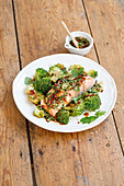 Steamed salmon fillet with oriental broccoli and sesame seeds