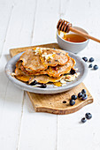 Blueberry and almond pancakes with honey