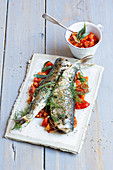 Grilled herb herring with an almond and tomato salsa