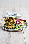 Spinach fritters with a mixed leaf salad