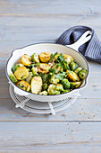 Brussels sprouts and fried potatoes with walnuts