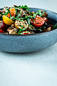 Aubergine salad with tomatoes and sesame seeds