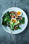 A breakfast bowl with quinoa, spinach and halloumi