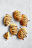 Coconut and sesame madeleines with choc drizzle