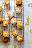 Individual fruit mince pies each with a star shape on top