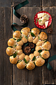 A festive bread wreath with black kale pesto and fresh herbs