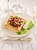 A puff pastry tart with sweet and sour vegetables
