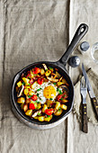 Potato breakfast pan with tomatoes and mushrooms