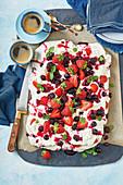 Warm white chocolate pavlova with berries