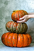 Three big beautiful pumpkins composed by a pyramid