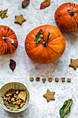 Cookies in the form of stars and letters from which the word October is laid out, pumpkins and autumn leaves