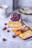Rectangular apple pie decorated with raspberries, blackberries and powdered sugar