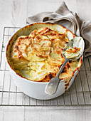 Gratin potato dauphinoise cut into to show cream and butter ingredients