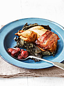 Quail cooked in vine leaves and wrapped in pancetta with grape confit