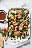 Cheat's roast pork tray bake with stuffing balls