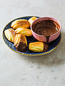 Orange madeleines with chocolate dipping sauce