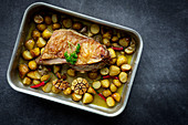 Roast lamb with potatoes and garlic