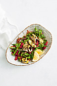 Chermoula-grilled calamari salad with chickpeas, beans and red capsicum