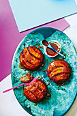 Hot banana, rum and raisin caramel puddings with chocolate sauce
