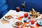 Amalfi-Thunfisch-Crudo mit Artischocken und Tomaten, Focaccia mit Sardellen und Haselnussbutter (Italien)